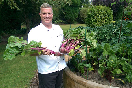Head chef Colin Wellburn harvests fresh beetroot.